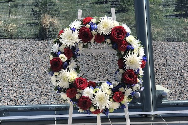 Glass Memorial Wall w/ Red, White & Blue Wreath | Military & Veterans Monuments | Mile High Memorials | Denver CO